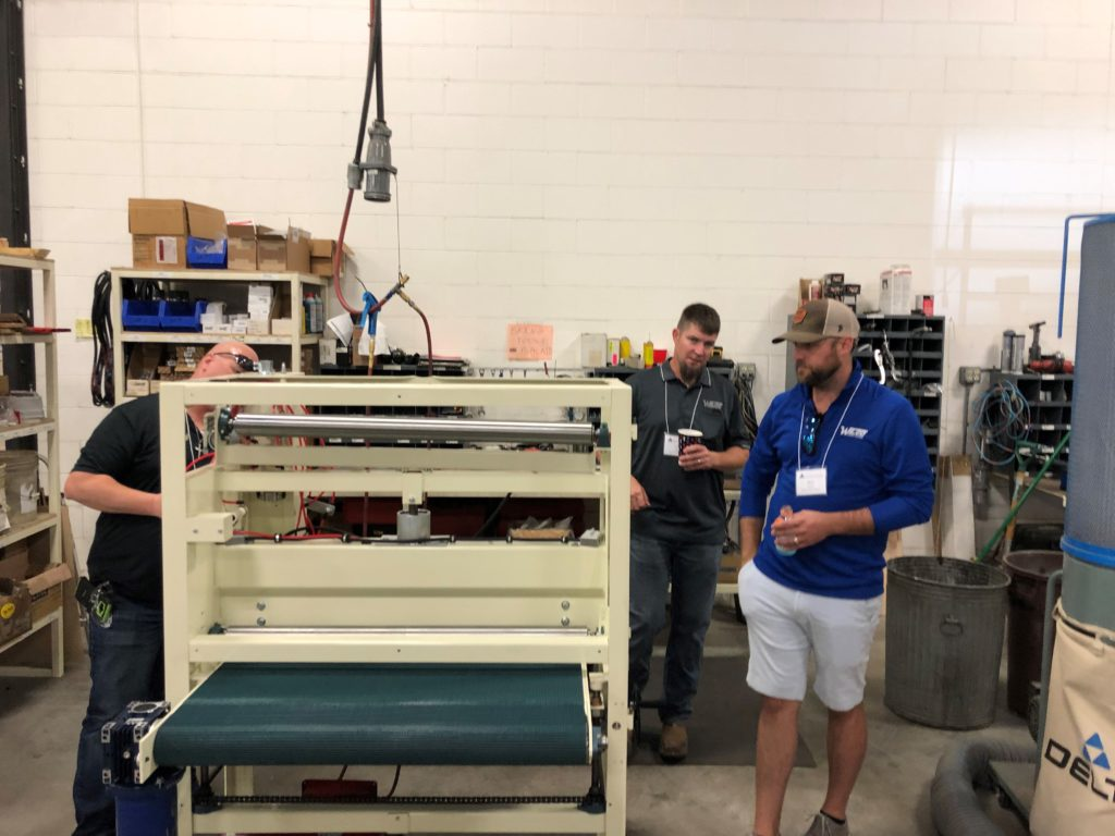 American Made Wide Belt Sander in production viewed by Cabinet Makers
